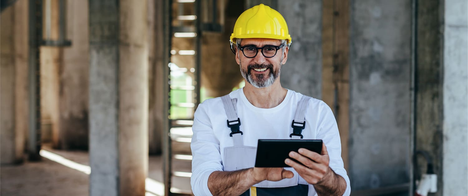 Smiling man holding a mobile device using VuSpex Virtual Building Inspections