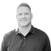 About VuSpex team member Dane Demicell. Black and white photo headshot.