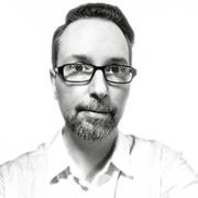 About VuSpex team member Todd Wahoske. Black and white photo headshot.