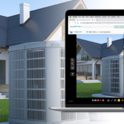 An Apple MacBook Air computer with VuSpex Virtual Inspections Inspector Dashboard for VuSpex AC on the screen with a picture of a house with an air conditioner in the foreground, next to an iPhone 12 with the same picture of an air conditioner. The background is a house setting with the same view as the computer and phone screens.